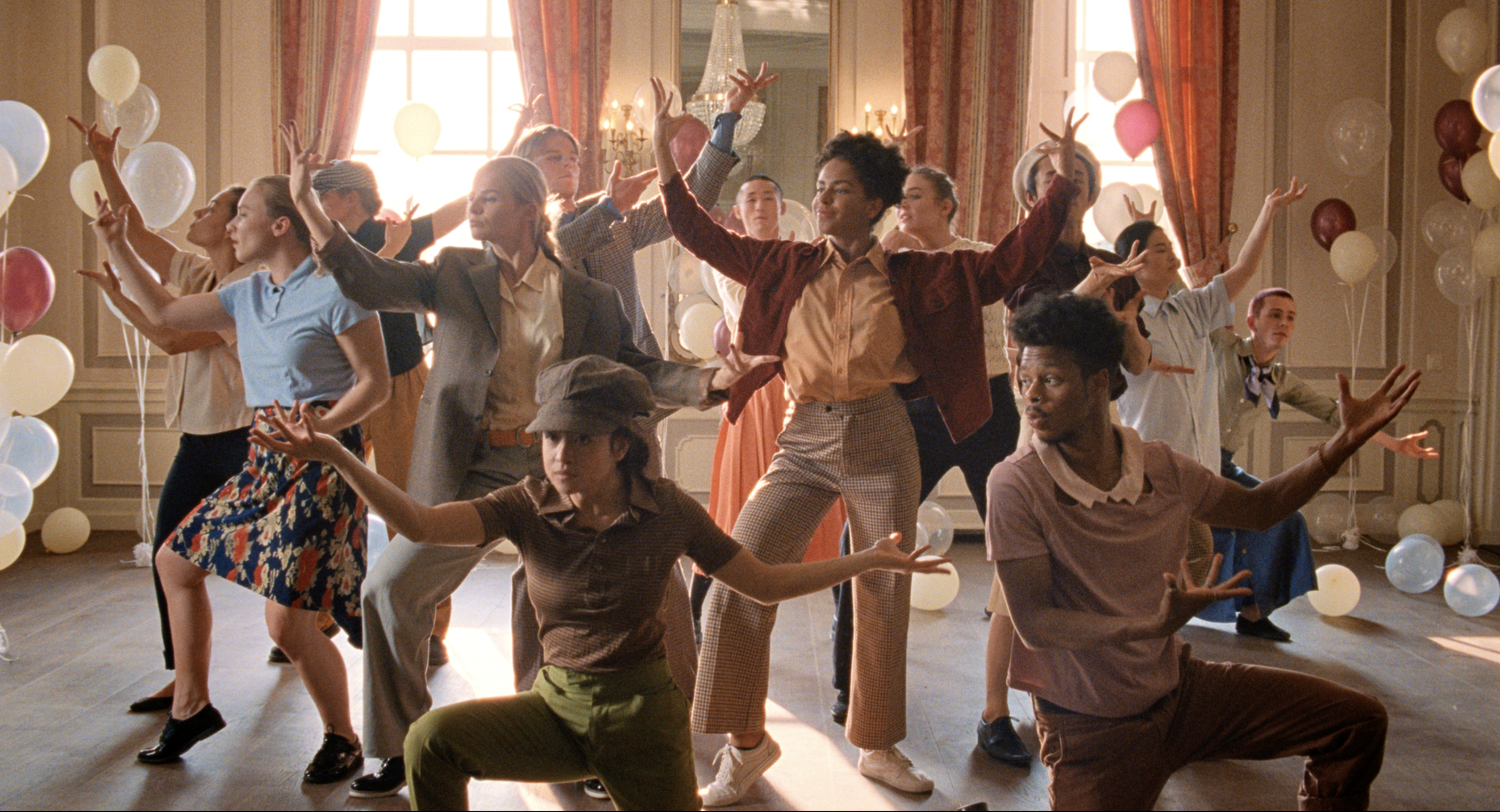 Still from the commercial For You. A group of dancers are doing a choreography in fancy room.