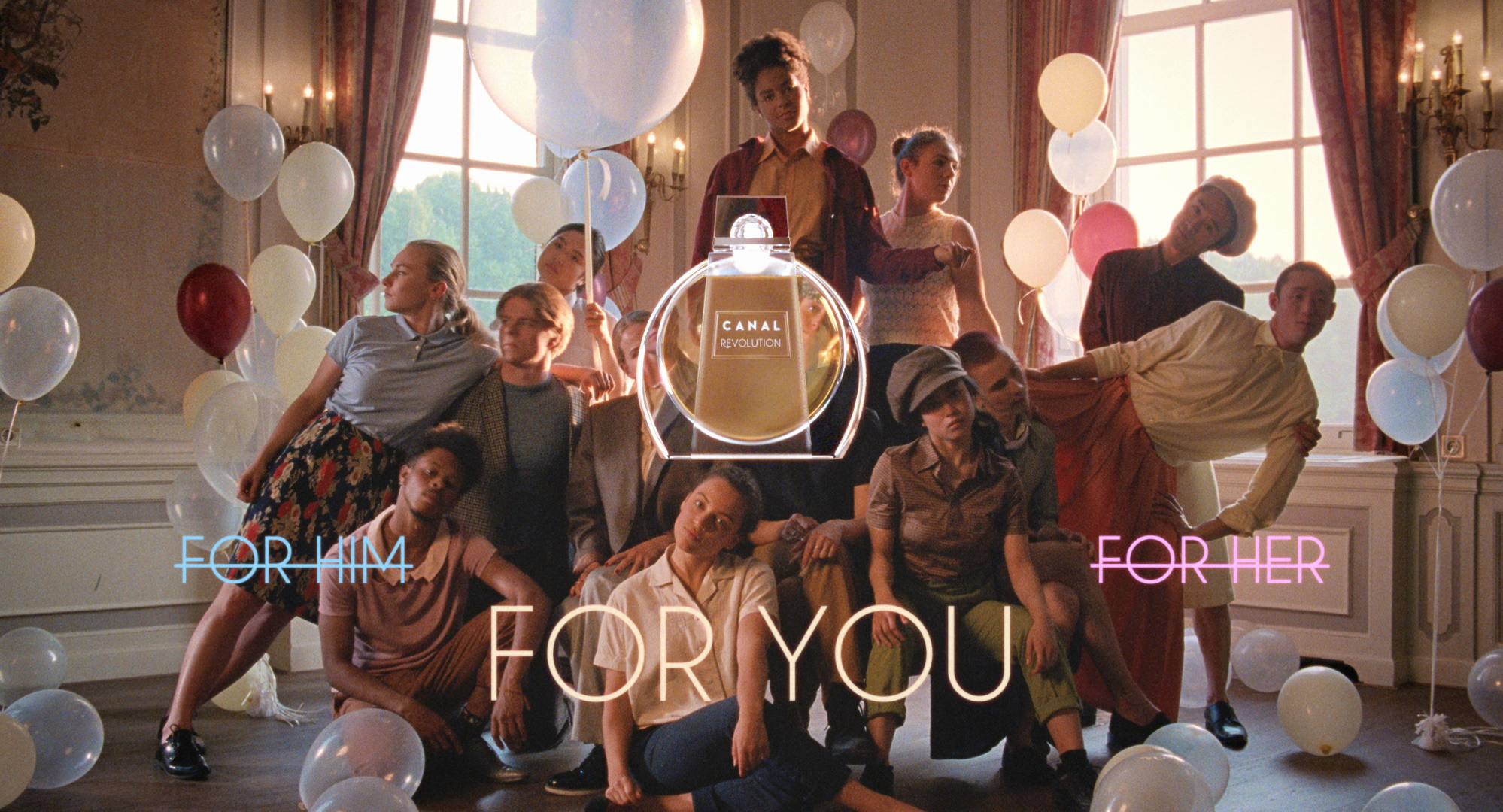 Still from the commercial For You. It's the final shot of the commercial, the group of dancers are posing in the back. Overlaid is a picture of the perfume, with the texts