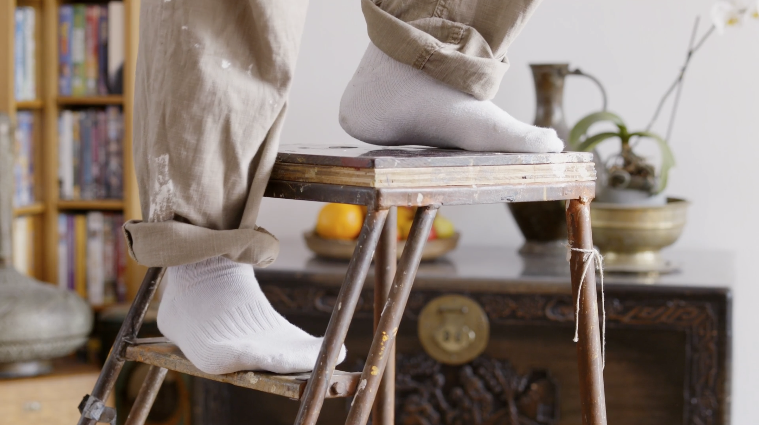 Still from the commercial Papa. It's a close up of feet on a stepladder.