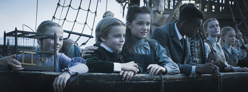 Still from Heirs of the Night. Medium shot of all of the Heirs standing at the bow of the Elisabetha.